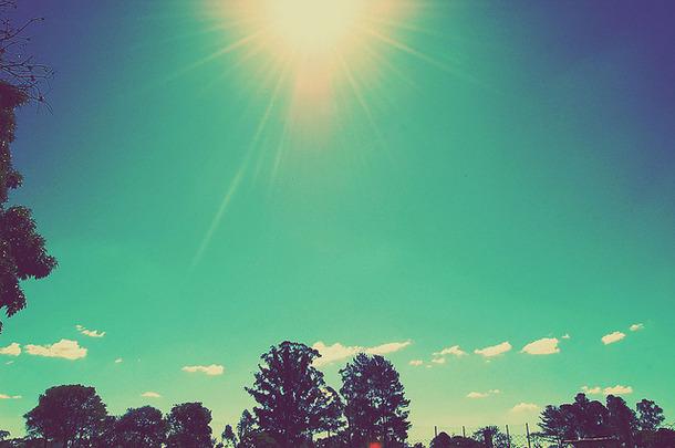 Favim.com-aged-blue-clouds-sky-sun-sunshine-45847