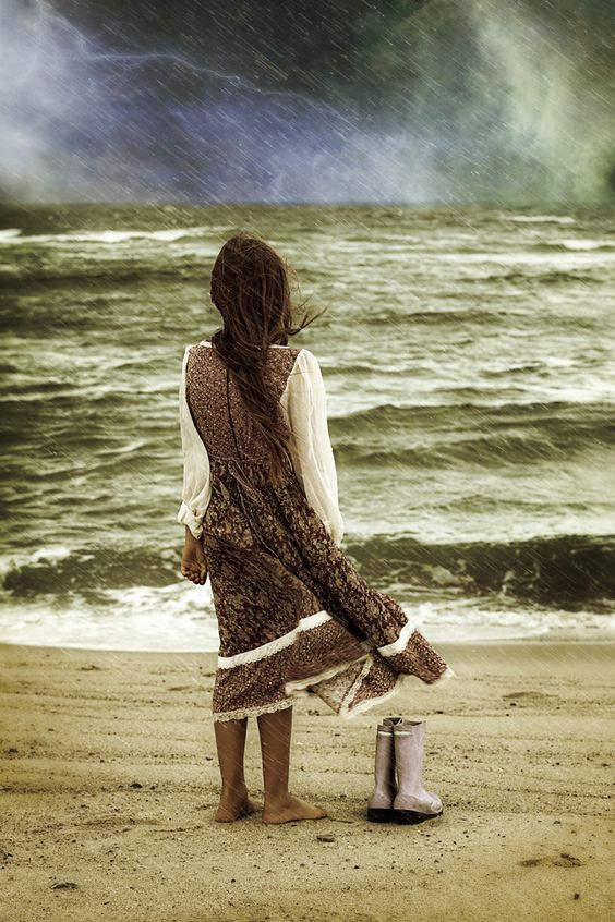 a girl at the beach during a storm